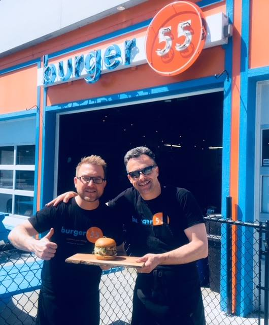 <who>Photo Credit: Facebook</who>Chris Boehm (L) and Ronald Bee (R) outside of Burger 55.